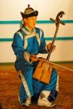 A musician plays a Morin Khuur (traditional horse-head violin), Tumen Ekh National Performers