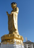 Mongolia's present and past -- a new statute of Buddha, with the Zaisan Memorial in the background