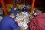 Counting the day offerings inside Jokhang
