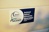 EVEN NOAO HAD TO LEAVE ITS MARK-THIS TIME ON THE SIDE OF A KITT PEAK VEHICLE