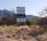 THIS SIGN GREETS ALL VISITORS TO KITT PEAK AS ONE TURNS  OFF THE MAIN HIGHWAY