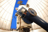 THE HUGE ARM SUPPORTS THE TELESCOPE AND IS COUNTER BALANCED BY A HUGE WEIGHT