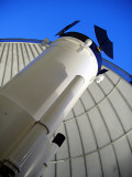 THE FLAPS AT THE END OF THE SARA TELESCOPE CLOSE TO KEEP  DEBRIS (LIKE BIRD POOP)  OUT OF THE TELESCOPE WHEN NOT IN USE