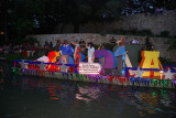 AS THE CROWDS FILLED IN THE SEATING THE FIRST FLOATS BEGAN TO ARRIVE.