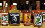 A CLOSE UP OF THE ENDLESS HOT SAUCES