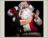 Woman kissing Santa
