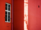 Shadow on pink house