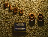 Bldg. 98 sign on wall at night