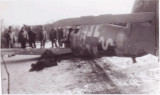 A picture taken from the opposite side showing the dead pilot lying on the left wing.