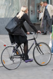 Blonde on bike (with flat rear tire)