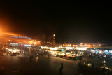 View of Place Djemaa El-Fna at night from the balcony of the Moroccan pizza restaurant.