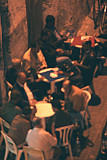 From my hotel roof, I took this at night with a telephoto lens of a typical (men only) Casablanca cafe scene; hence, it's fuzzy.