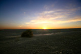 I captured this desert sunset while driving between Erfoud and Merzouga in southern Morocco.