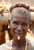Tamberma woman with a white stone pierced through a hole under her lip.