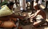 Hindu rituals at the Holy River Kaveri in Srirangam, Tamil Nadu, India