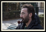 A pipe-smoker by the canal