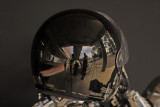 REFLECTIONS IN A MOTOR CYCLE HELMET