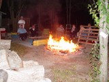THE FIRE RING WAS ABLAZE WITH WOOD SUPPLIED BY TWIN OAKS