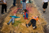 Before they are swept away, kids find one last use for the alfombras.