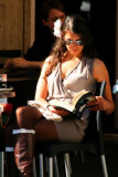 Woman reading in a cafe