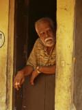 Man in doorway Trivandrum.jpg