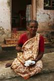 woman in front of her house Kanyakumari.jpg