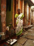 Woman in small alley Madurai.jpg