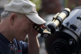 Me looking through H-Alpha 40 mm solar scope