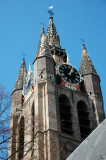 The brick spire with the four angle towers is reminiscent of Flemish architecture.