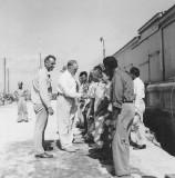 HiCom Midkiff  greets people Ebeye 1950