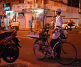 Street vendor with roasted squids, Saigon