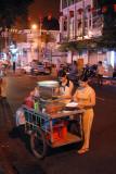 Street vendors making salads, Saigon