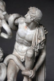 A son of  Laocoön struggling against the serpent