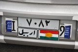 Car with Kurdish flag pasted over the name Iraq