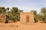 Small hut among the palms on the east bank of the Nile near the Old Dongola Ferry