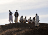 Sudanese men waiting for the Old Dongola Ferry on the West Bank