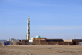 Village with a tall minaret at km 407