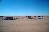 Tiny settlement on a vast empty plain