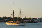Two-masted sailing ship painted with the colors of the flag of Mauritius