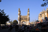 Busy streets radiate in the four cardinal directions from the Charminar