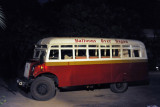 Ancient British bus from the colonial-era picking up passengers for Balloons over Bagan