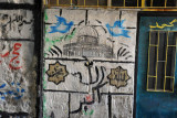Graffiti with doves over the Dome of the Rock and the phrase Allah Akbar