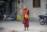 Burmese monk with a begging bowl, Mandalay