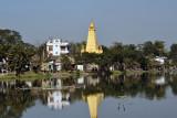 Golden pagoda on the Thinga Yarzar Canal from the Bayintnaung Road bridge, Mandalay