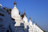Stupas housing the 729 marble slabs recording the Tripitaka - 15 volumes of Bhuddist scripture
