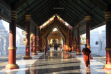 Covered walkway leading to the main temple at Kuthodaw Paya, Mandalay