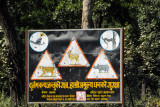 Chitwan buffer zone - warning signs for Tiger, Rhino, Python, Chital (spotted deer) and Crested Hornbill