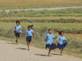 Girls running, late for school, Sauraha
