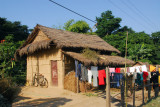 Small thatched house with the laundry out to dry, Central Terai