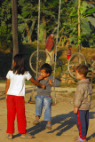 Children playing on the swing, Sauraha Chowk (Tandi Bazaar)